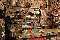A woman sits behind the counter of a bar in Batumi...