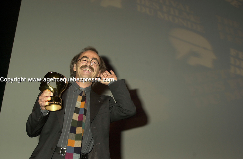 Sept 2, 2002, Montreal, Quebec, Canada<br /> <br />  Jury Member MAURIZIO NICHETTI<br />  listen to a recording of Sophie Marceau accepting her prize for Best Director<br />  (for her first time movie PARLEZ MOI D AMOUR),<br /> on the closing night of the Montreal World Film Festival<br /> Sept 2, 2002<br /> <br /> <br /> <br /> Italian writer, producer, actor, director and all-round funnyman, Milan-born Maurizio Nichetti began working as a screenwriter for animator Bruno Bozzetto in the 1970s, directed shorts for the RAI TV network, then made his acting debut in ALLEGRO NON TROPPO in 1976. Three years later he made his feature debut as a director with RATATAPLAN, a critical and commercial hit. He hosted shows on television and has continued turning out comic shorts and features, including THE ICICLE THIEF (1989), a sophisticated lampoon/homage to De Sica, and VOLERE VOLARE (1991), which won both best script and the audience prize at the Montreal World Film Festival. <br /> <br /> <br /> Mandatory Credit: Photo by Pierre Roussel- Images Distribution. (&copy;) Copyright 2002 by Pierre Roussel <br /> <br /> NOTE : <br />  Nikon D-1 jpeg opened with Qimage icc profile, saved in Adobe 1998 RGB<br /> .Uncompressed  Uncropped  Original  size  file availble on request.