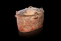 The Minoan clay burial larnax chest with swirl design,  Neopalatial period 1700-1450 BC; Heraklion Archaeological  Museum, black background.