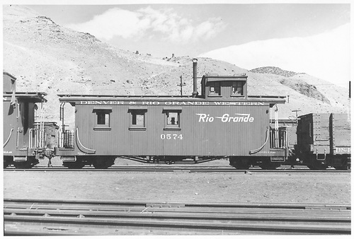 Long caboose #0574.<br /> D&amp;RGW  Salida, CO  Taken by Maxwell, John W. - 3/17/1950