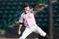 Hickory Crawdads relief pitcher Tyler Smith (10) in action against the Augusta GreenJackets at L.P. Frans Stadium on May 11, 2014 in Hickory, North Carolina.  The GreenJackets defeated the Crawdads 9-4.  (Brian Westerholt/Four Seam Images)