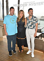 "LOS ANGELES, USA. June 11, 2019: Adam Sandler, Jennifer Aniston & Luis Gerardo Mendez at the photocall for ""Murder Mystery"" at the Ritz Carlton, Marina del Rey.<br /> Picture: Paul Smith/Featureflash"