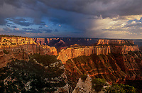 749220293 sunset lights up the ancient geological formations around cape royal as a summer monsoon storm clears over the north rim of grand canyon national park in arizona