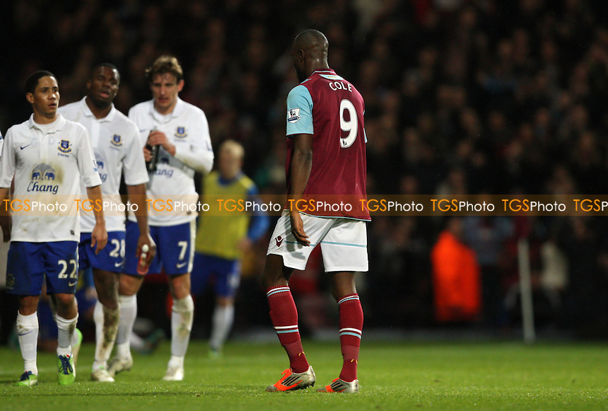 Carlton Cole of West Ham trudges off after being sent off - West Ham United vs Everton, Barclays Premier League at Upton Park, West Ham - 22/12/12 - MANDATORY CREDIT: Rob Newell/TGSPHOTO - Self billing applies where appropriate - 0845 094 6026 - contact@tgsphoto.co.uk - NO UNPAID USE.