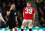 Referee Craig Pawson points to his eye while talking to Scott McTominay of Manchester United during the FA Cup match at the Pride Park Stadium, Derby. Picture date: 5th March 2020. Picture credit should read: Darren Staples/Sportimage