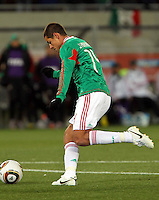 Javier Hernandez of Mexico scores the opening goal against France