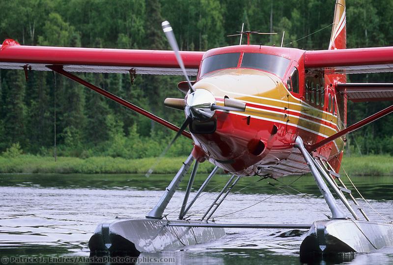 An otter bush plane on floats taxis on a lake in Talkeetna, Alaska.