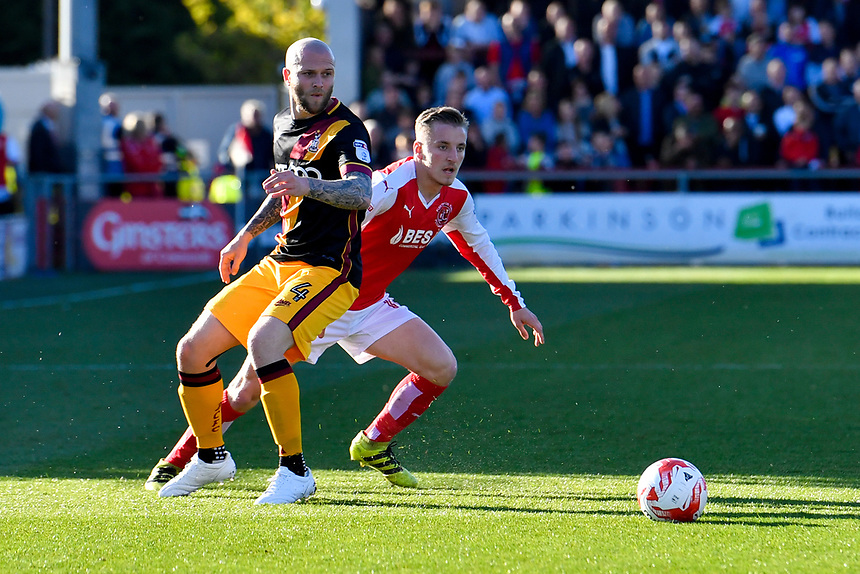 Fleetwood Town's George Glendon skips past Bradford City's Nicky Law<br /> <br /> Photographer Terry Donnelly/CameraSport<br /> <br /> The EFL Sky Bet League One Play-Off Second Leg - Fleetwood Town v Bradford City - Sunday 7th May 2017 - Highbury Stadium - Fleetwood<br /> <br /> World Copyright &copy; 2017 CameraSport. All rights reserved. 43 Linden Ave. Countesthorpe. Leicester. England. LE8 5PG - Tel: +44 (0) 116 277 4147 - admin@camerasport.com - www.camerasport.com