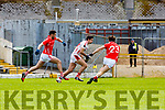Aidan O'Mahony Rathmore takes on Jack Sherwood and Con O'Mahony East Kerry clash during their SFC clash in Fitzgerald Stadium on Sunday