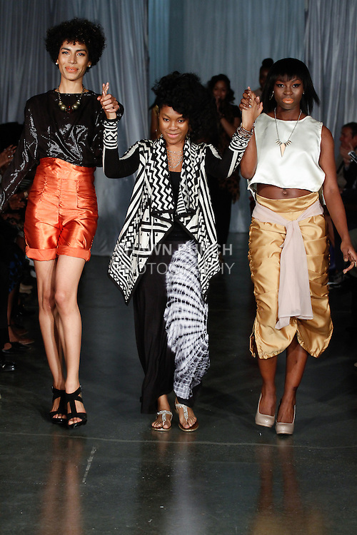 Fashion designers walk runway with models at the close of  the Maxwell High School Spring Summer 2014 collection fashion show, during Fashion Week Brooklyn Spring Summer 2014 on October 3, 2013.