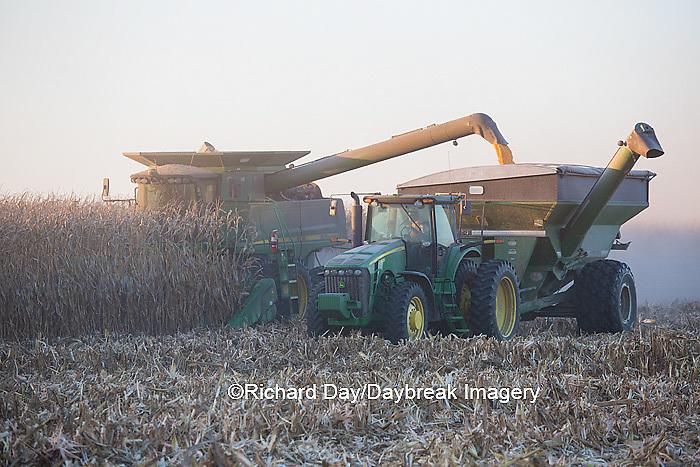 63801-06611 John Deere combine harvesting corn while unloading corn into wagon, Marion Co., IL