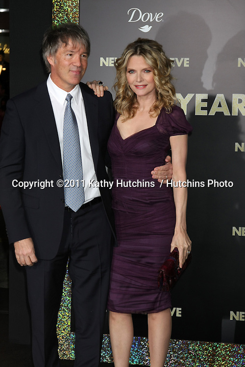"""LOS ANGELES - DEC 5:  David E. Kelley, Michelle Pfeiffer arrives at the """"New Year's Eve"""" World Premiere at Graumans Chinese Theater on December 5, 2011 in Los Angeles, CA"""