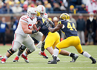 Ohio State Buckeyes offensive lineman Billy Price (54) and offensive lineman Taylor Decker (68) against Michigan Wolverines at Michigan Stadium in Arbor, Michigan on November 28, 2015.  (Dispatch photo by Kyle Robertson)