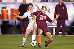 07 November 2008: Virginia's Lindsey Miller (5) and Virginia Tech's Jennifer Harvey (20). The University of Virginia and Virginia Tech played to a 1-1 tie after 2 overtimes at WakeMed Stadium at WakeMed Soccer Park in Cary, NC in a women's ACC tournament semifinal game.  Virginia Tech advanced to the final on penalty kicks, 2-1.