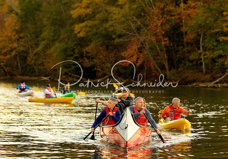 People (models) kayak along the Catawba River as they participate in a Micro Brews Cruise outing at the US National Whitewater Center in Charlotte, NC. The USNWC, an ultimate adventure playground for outdoor enthusiasts, offers both water and land sports. Micro Brews Cruise offers flatwater kayaking, fireside dinner and craft beer tastings on select nights.