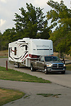 Dodge towing fifth wheel at campground.