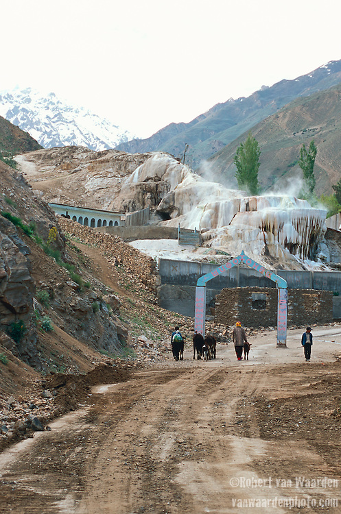 A group of people approach the Garm-Chashma hot springs in the Ishkashim District of the Tajikistan mountains.