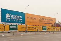 Daytime landscape view of the New Blue Diamond commercial construction site on Hang Hai Dong Lu in the Guǎnchéng Huízú Qū of Zhengzhou in Henan province.  © LAN