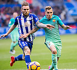 Club Deportivo Alaves'es forward Aleksandar Katai competes for the ball with FC Barcelona's defender Lucas Digne during the match of La Liga between Deportivo Alaves and Futbol Club Barcelona at Mendizorroza Stadium in Vitoria, Spain. February 11, 2017. (ALTERPHOTOS/Rodrigo Jimenez)