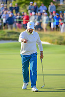 Anirban Lahiri (IND) follows his birdie putt home on 16 during round 3 Four-Ball of the 2017 President's Cup, Liberty National Golf Club, Jersey City, New Jersey, USA. 9/30/2017.<br /> Picture: Golffile | Ken Murray<br /> <br /> All photo usage must carry mandatory copyright credit (&copy; Golffile | Ken Murray)