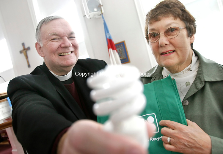 MIDDLEBURY, CT. 21 December 2007-122107SV01--Rev. Bill Hardwick and Janet Gilnack of the St. George's Episcopal Church show off some of the items the church is using to go green and save energy at the church in Middlebury Friday.<br /> Steven Valenti Republican-American
