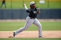 Lansing Lugnuts third baseman Vladimir Guerrero Jr. (27) throws to second base during a game against the Clinton LumberKings on May 9, 2017 at Ashford University Field in Clinton, Iowa.  Lansing defeated Clinton 11-6.  (Mike Janes/Four Seam Images)