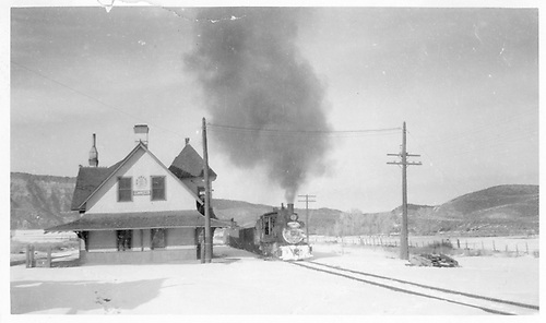 C-18 #318 with freight passes Ridgway depot.<br /> RGS  Ridgway, CO  1/24/1953