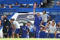 Chelsea Manager, Maurizio Sarri, tries to get the attention of the match referee so he can make a couple of substitutions during Chelsea vs Lyon, International Champions Cup Football at Stamford Bridge on 7th August 2018