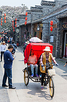 Yangzhou, Jiangsu, China.  Dong Guan Street Scene with Pedicab.