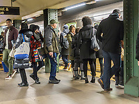 Long suffering subway riders wait for a train at the Lexington Avenue-59th Street station on the New York subway on Saturday, December 17, 2016. New York State Governor Andrew Cuomo announced that revenue service on the Second Avenue subway line will begin on January 1, 2017 alleviating some of the crowding on the East Side of Manhattan. (© Richard B. Levine)