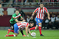 BUKARESZT 09.05.2012.MECZ FINAL LIGA EUROPY SEZON 2011/12: ATLETICO MADRYT - ATHLETIC BILBAO --- UEFA EUROPA LEAGUE FINAL 2012 IN BUCHAREST: CLUB ATLETICO DE MADRID - ATHLETIC CLUB DE BILBAO.MARKEL SUSAETA  FILIPE LUIS  MARIO SUAREZ.FOT. PIOTR KUCZA.---.Newspix.pl