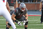 Noah Osur-Myers, Washington State offensive lineman, prepares for the snap during the Cougars Pac-12 Conference demolition of the Arizona Wildcats, 69-7, on November 5, 2016, at Martin Stadium in Pullman, Washington.