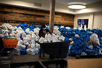 NEW YORK CITY, NY - MAY 05: Staff member packs food to distribute to needy residents of NYC through emergency food programs on May 05 ,2020. Food inequality effects 2 million residents in the city , according to a study by Hunger Free America. (Photo by Joana Toro /VIEWpress)