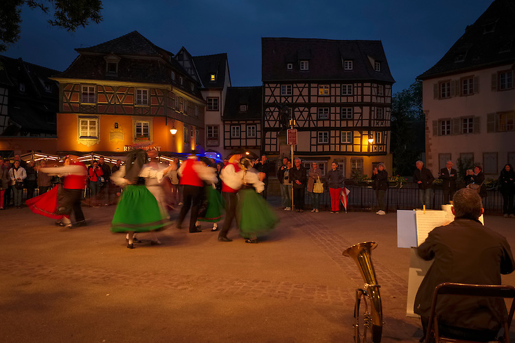 Folk dancing provides entertainment for visitors in the old city center of Colmar.