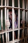 Allison in a Jail cell at Alcatraz in San Francisco, California. (Photo by Brian Garfinkel)