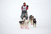 Ksenia Deits runs on the inbound trail towards the finish line of the 2016 Junior Iditarod in Willow, Alaska, AK  February 28, 2016