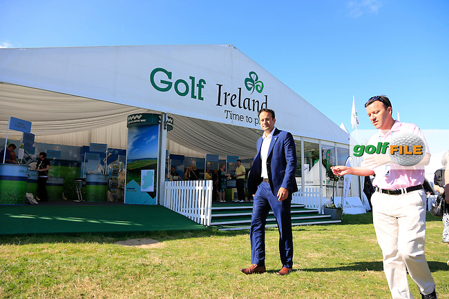 Minister Leo Varadkar visiting the Failte Ireland stand in the tented village with European Tour Commercial director James Finnegan at the Irish Open, Fota Island, Cork, Ireland.<br /> Picture:  Fran Caffrey www.golffile.ie