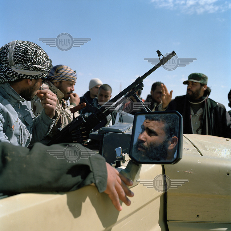 Rebel fighters discuss tactics near Ajdabiya. On 17 February 2011 Libya saw the beginnings of a revolution against the 41 year regime of Col Muammar Gaddafi.