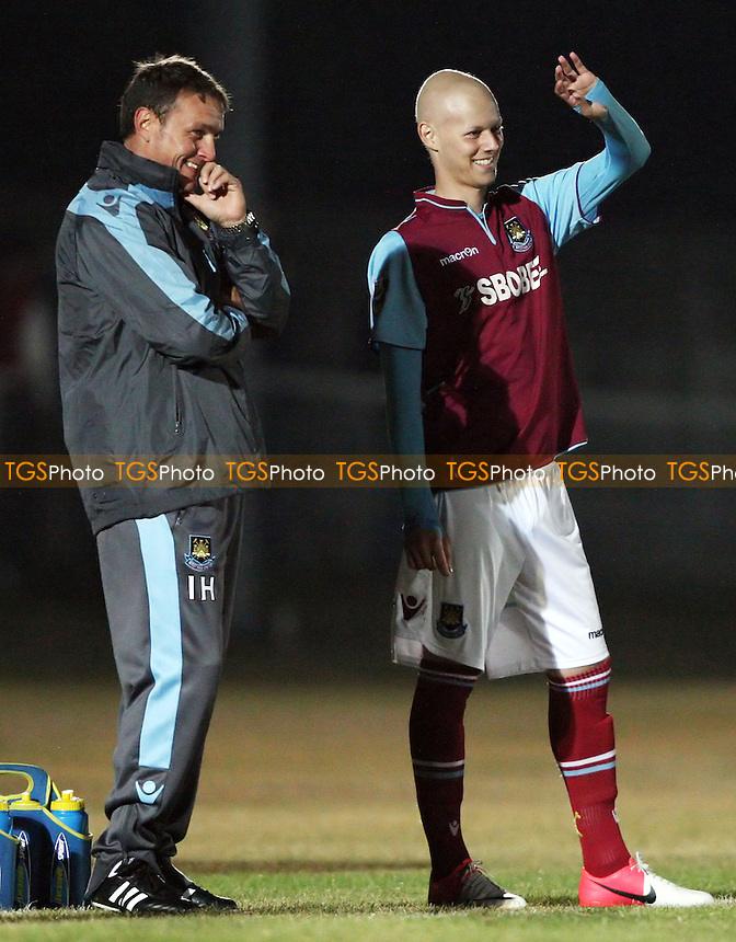 Dylan Tombides of West Ham prepares to come on as a 2nd half sub and shares a joke with Ian Hendon - West Ham United Development Squad vs Arsenal Development Squad, Barclays Under-21 Premier League Group 1 at Rush Green Stadium, Rush Green - 21/09/12 - MANDATORY CREDIT: Rob Newell/TGSPHOTO - Self billing applies where appropriate - 0845 094 6026 - contact@tgsphoto.co.uk - NO UNPAID USE.