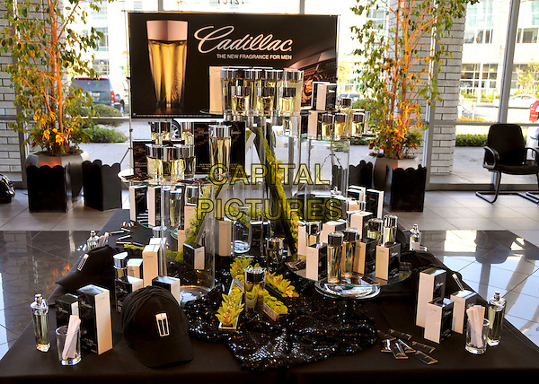 """ATMOSPHERE .""""Cadillac: The New Fragrance for Men"""" Launch Party held at Martin Cadillac, Los Angeles, CA, USA, 23rd July 2009..bottles perfume logo .CAP/ADM/BP.©Byron Purvis/Admedia/Capital Pictures"""