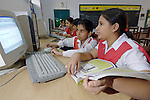 Students studying with computers at the Lucie Harrison Girls High School in Lahore. The school is run by the Church of Pakistan.