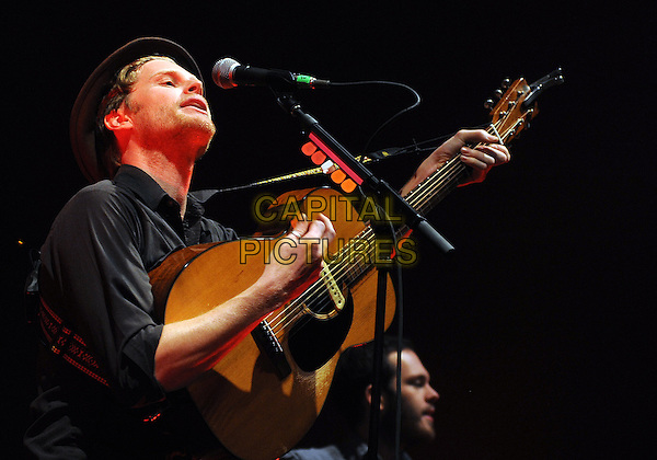 Vocalist/guitarist WESLEY SHULTZ for the American folk rock band THE LUMINEERS performs to a Sold Out concert at a stop on their U.S. tour held at the Stage AE, Pittsburgh, PA., USA..February 5th, 2013.on stage in concert live gig performance performing music half length black shirt guitar singing side profile .CAP/ADM/JN.©Jason L Nelson/AdMedia/Capital Pictures.