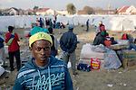 PRIMROSE, SOUTH AFRICA - MAY 23: Moses Balan, age 24, a Zimbabwean refugee, stands outside a tent camp on May 23, 2008 at Primrose police station outside Johannesburg, South Africa. He was chased out with other African immigrants and many shacks were burned down during xenophobic attacks in the township. A man was burned alive down the street and thousands of people fled to a nearby police station for safety. (Photo by: Per-Anders Pettersson/Getty Images).