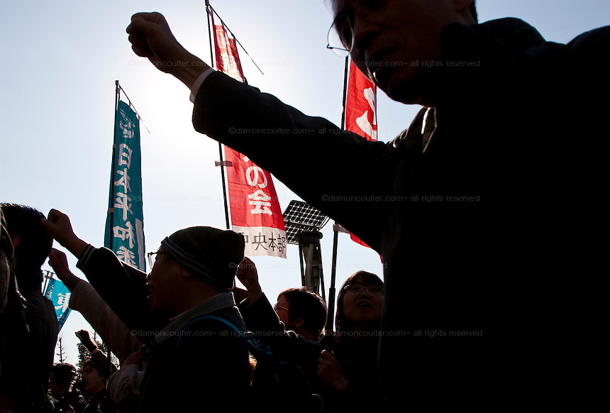 "Supporters punch the air during the demo march to the Japanese Diet building after the Anti poverty Protest ""Tent Village"" in Hibiya Park, Tokyo.  Japan. Monday, January 5th 2009. Organised by the Moyai Foundation, headed by Makoto Yuasa, for the six days the event lasted over the New Year`s holiday in 2009 about 1,600 volunteers helped over 500 of Japan`s homeless and unemployed with food, shelter and advice."