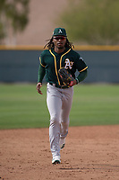 Oakland Athletics center fielder JaVon Shelby (13) jogs off the field between innings of a Minor League Spring Training game against the Chicago Cubs at Sloan Park on March 13, 2018 in Mesa, Arizona. (Zachary Lucy/Four Seam Images)