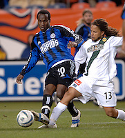 Colorado Rapids forward Jean Philippe Peguero is tackled by LA midfielder Cobi Jones. The Colorado Rapids lost to the LA Galaxy 2-0 in the Western Conference Finals, November 5, 2005, at Ivesco Field at Mile High in Denver, CO.