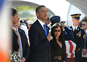 United States President Barack Obama and first lady Michelle Obama stands as the casket of the late Senator Daniel Inouye (Democrat of Hawaii) is carried by a military honor guard at the National Memorial Cemetery of the Pacific during ceremonies. Senator Inouye was a Medal of Honor recipient and a United States Senator since 1963.  .Credit: Cory Lum / Pool via CNP