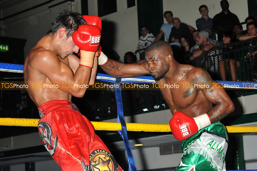 Larry Ekundayo (green shorts) defeats Stanislav Nenkov - Boxing at York Hall, Bethnal Green, London - 11/10/14 - MANDATORY CREDIT: Philip Sharkey/TGSPHOTO - Self billing applies where appropriate - contact@tgsphoto.co.uk - NO UNPAID USE