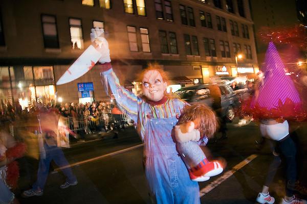 """A person dressed up as Charles Lee Ray, or """"Chucky"""" from the horror movie series of the same name, in New York's 35th Annual Village Halloween Parade."""