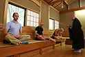 July 20, 2010 - Niiza, Japan - Foreign tourists practice Zazen, a meditative discipline practitioners perform to calm the body and the mind, at Heirin-ji, a Rinzai temple of the Myoshin-ji branch located in Niiza city, Saitama prefecture, Japan, on July 20, 2010. The activity is part of the 'True Japan Saitama - Zen Medidation and Buddhist Vegetarian Cuisine' tour, organized by the travel agency JTB for leisure travelers.
